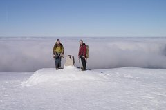 Rock Climbing Photo: The summit trig point, looking out over a cloud in...