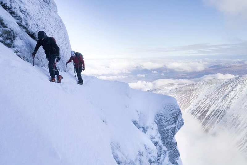 Soloing Eastern traverse. Hard snow and a ledge dug out by previous parties make this a much easier proposition<br> <br> Photo by Alastair Begley - http://www.masterplan-photography.co.uk