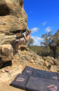 Rock Climbing Photo: Traversing out the rail Pack Rat Roof (V3)