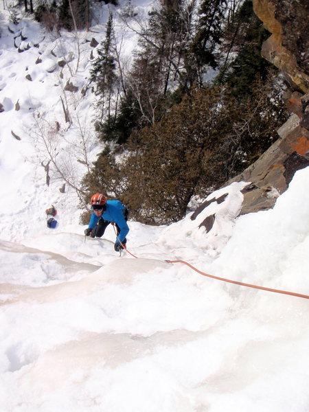 Carter Stritch climbing towards the belay