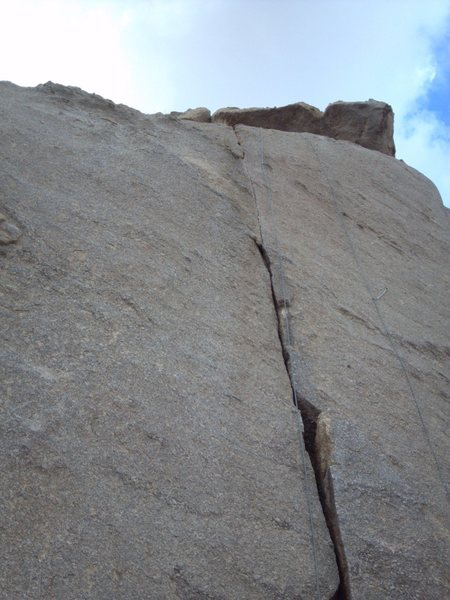 Looking up at the thin crack of Sweet Surprise. North face of The Loaf.