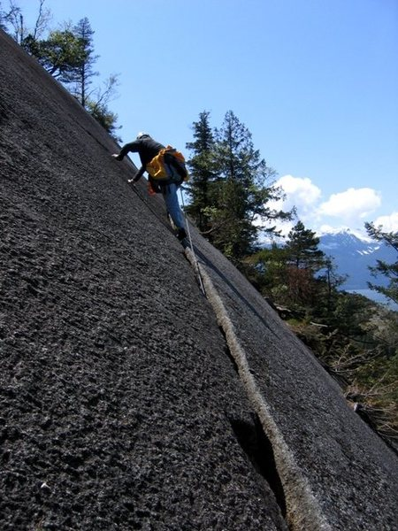 Continuing on the foot ledge on the second pitch of Banana Peel