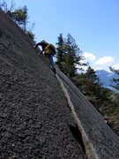 Rock Climbing Photo: Continuing on the foot ledge on the second pitch o...