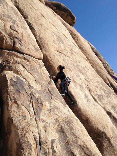 Climbing B-3 5.3 on top rope. Natural anchors are required for this route.
