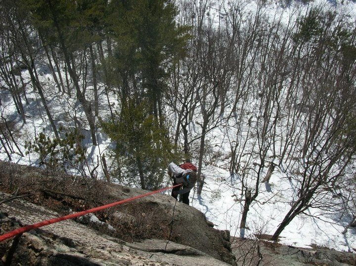 Jon Garlough doing some late Winter scrubbing of a new route on Longstack Precipice.