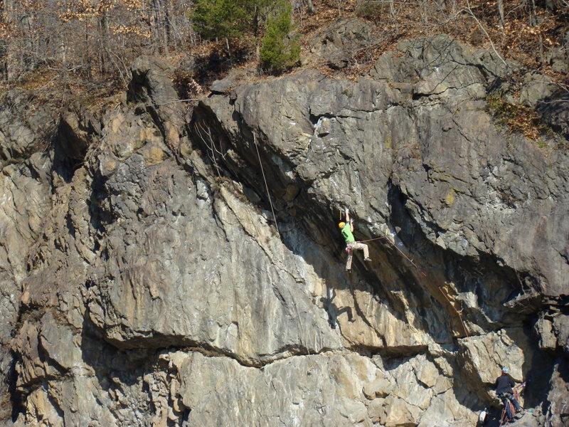Chris Acosta climbing Magnanimous