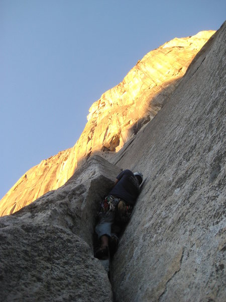 Ben Karin jamming the awkward flaring crack on the third pitch on an unusually warm evening in December.