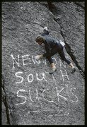 Rock Climbing Photo: KC checking out someone's unwelcome graffiti on th...