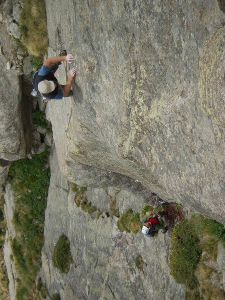 Ken engages the arete, belayed by Marsha Trout on the FA.