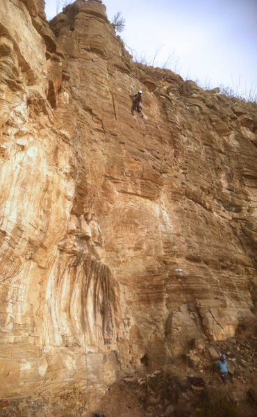 Leo just past midway on FA<br> Wishbone Right (5.10-)