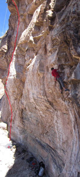Slither takes a snaking line around and over several bulges which are 25 feet left of Fa-Lufa - the climber is on Fa-Lufa