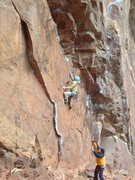 Rock Climbing Photo: Vanya about to make the big move to the rail getti...