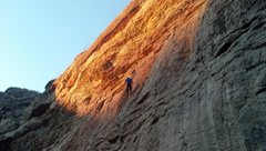 Rock Climbing Photo: Michael Baker, cleaning up gear at the end of the ...