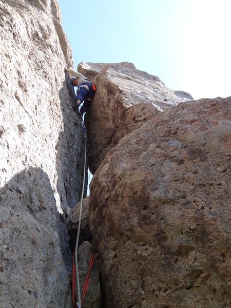 Stuck between a rock and a hard place on the Far Side Chimney 5.6. Photo by Roy Benton.