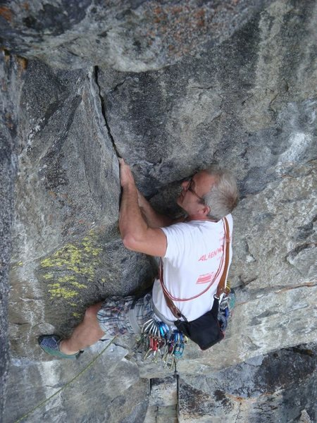 Airy crack climbing leads to the Bone roof.  Jake Evans.