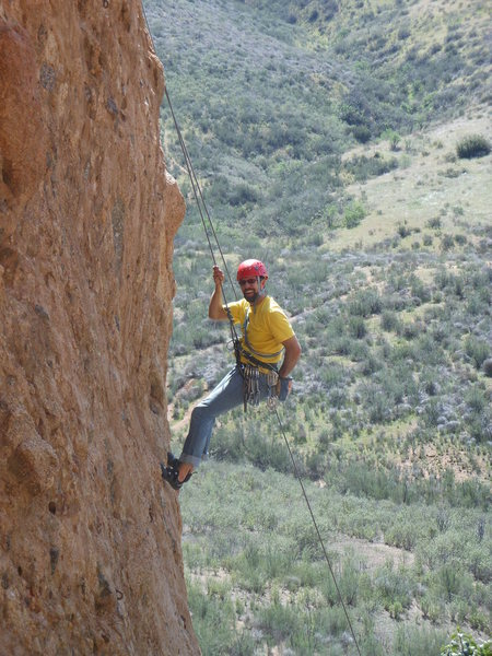 "Climber working the crux of ""Amarillo by Morning."""