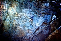 Rebecca climbing Tensile Strength, surrounded by the scars of Quincy's urban history.