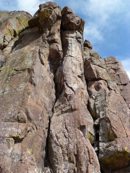 The route ascends the wide crack in the center.  The rope is on Major Bolt Achievement.