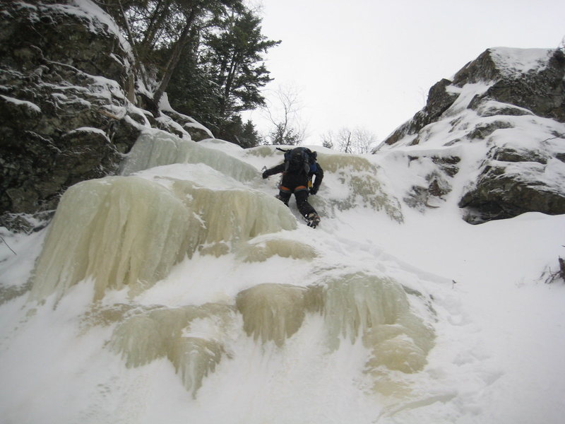 Scramblin' up an ice step.  Photo by Kevin Chlad