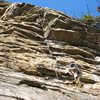 A climber following on Son of Easy O at the Gunks.