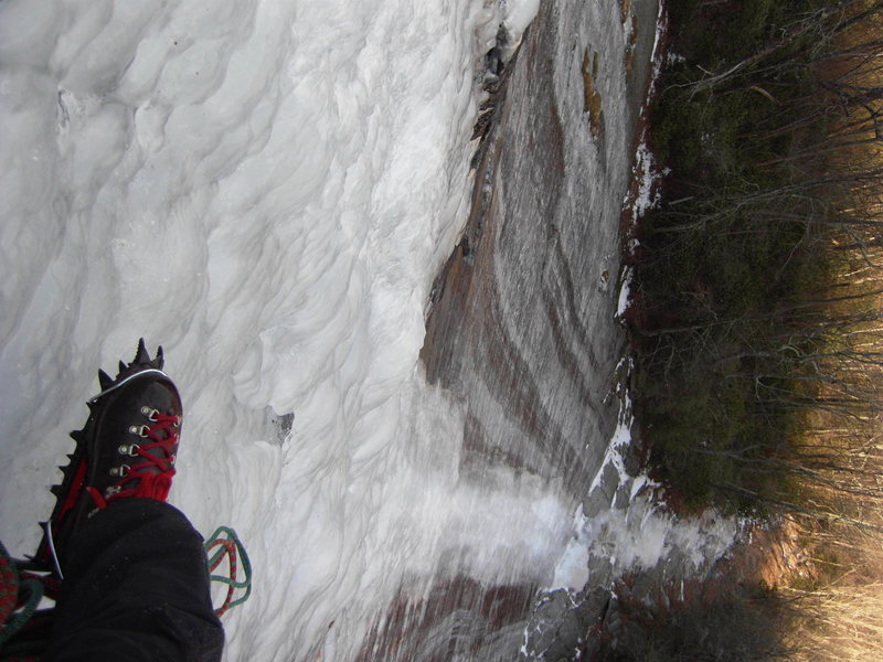 Looking down past my old school Habeler Superlight boot and Lowe footfang, from the P1 belay, Starshine, March 2013