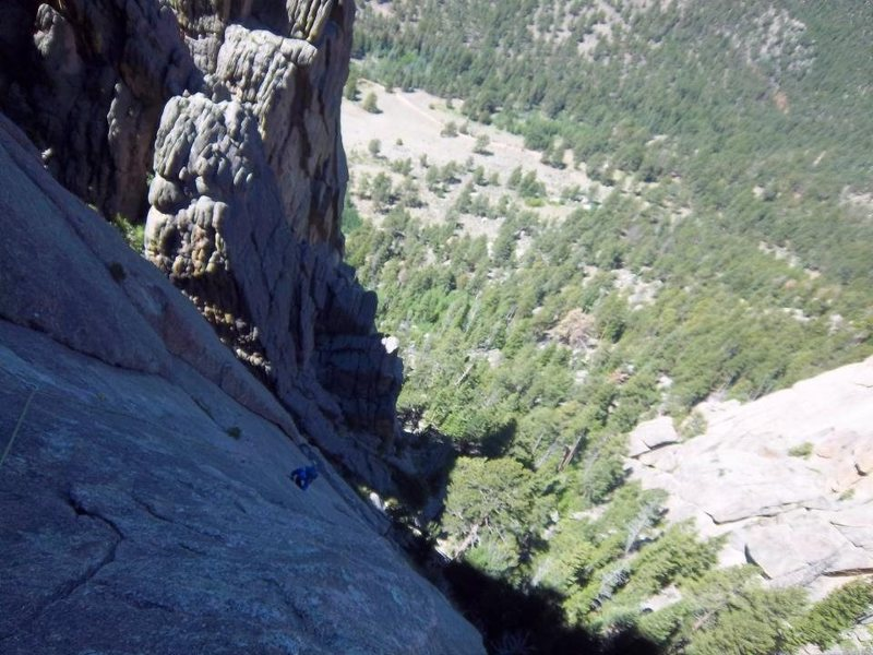 Me coming up the thin, flaring crack on p2 of White Whale.  fun stuff.<br> <br> Photo by Simon Thompson.