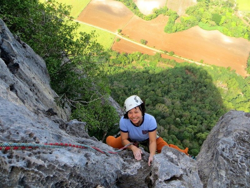 Pitch 5 of Corcovado - fun climbing on a beautiful limestone mountain.  Sunflower fields below are in (partial) bloom.  Jan. 2013.