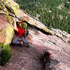 Coming out of the &quot;awkward slot&quot; on the 6th pitch of the Direct East Face (5.6) of the First Flatiron, Boulder, CO. Locals solo routes like this just for fun during lunch breaks, so I had to pay respect to the tradition. Fun indeed! =)<br> <br> Photo by Joe Grant.