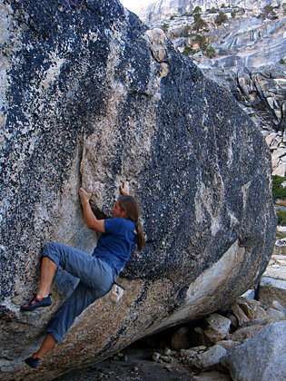 Going up the Flakes boulder problem, The Cube, Tuolumne Meadows, Yosemite, CA.