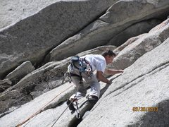 Cary Siteman climbing in the crack toward the top of Errant Edge.