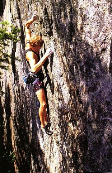 Greg Collum on Young Cynics (5.12d), Index Town Walls. Photo by Larry Kemp (1989).