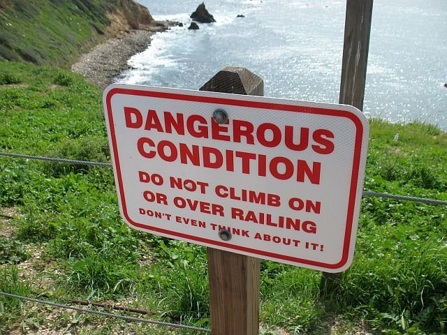Warning sign and Seaspray Rock, Palos Verdes Peninsula