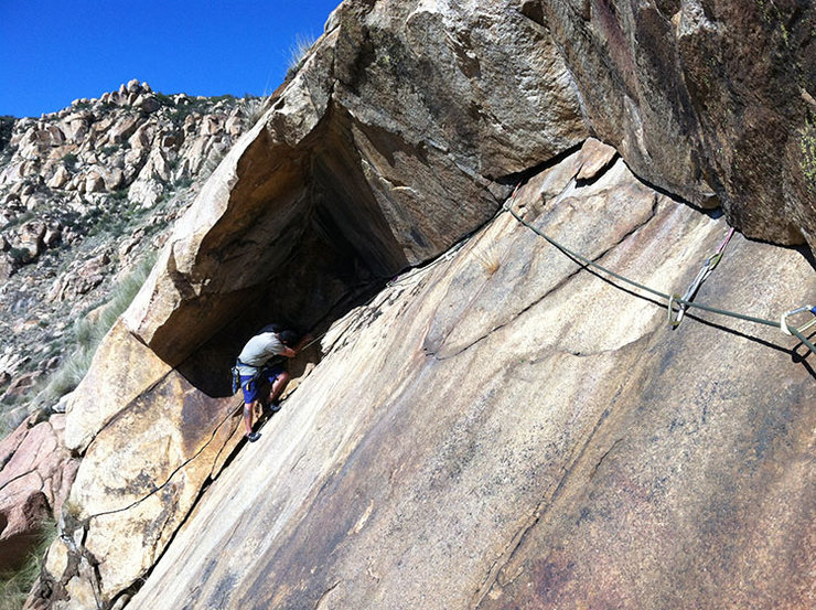 Steve follows the traverse into the chimney (start variation)