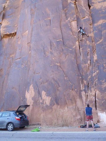 Climbing at Wall Street, Moab. Pinhead Trad 5.10b