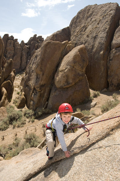Bryson (5 years old in this photo) climbs Fiddlin' Buckaroo, in the Alabama Hills.