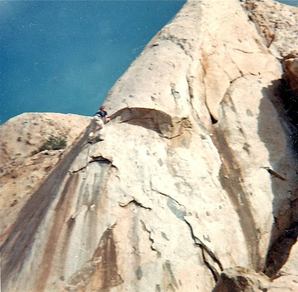 "Keith Leaman wearing epoxied Cortinas on ""Roman Nose"" 5.9+ 1966. This quality formation contained several excellent routes, made inaccessible by the 1971 dam. FA Lee Harrell early '60s."