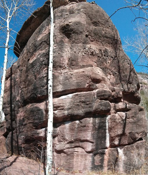 The seam is on the west face of the boulder.