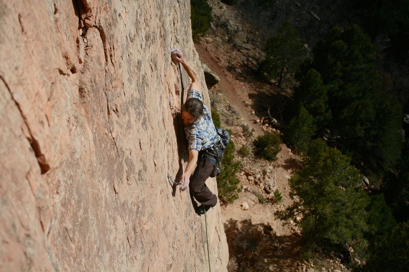 This route does not super suck. <br> <br> Climber: Ben I.<br> Photo: Travis M.