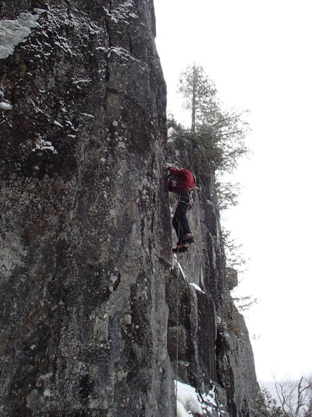 Getting through the crux.  Good tools but poor feet.