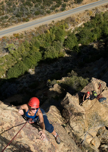 Amy nears the top of the summit block on Spontaneous Order, at the Fortress.