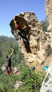 Rock Climbing Photo: Abner cranking the big move to the lip!