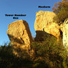 The twin tower boulders. A 10 minute walk up the river bed from the road.