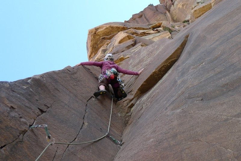 Rachel enjoying the balancing moves on pitch 4.  We climbed up another 10ft then traverse left to the bolted anchor.  Short pitch