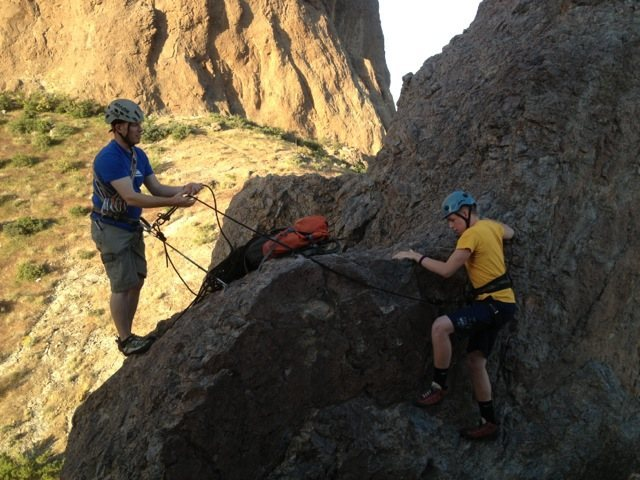 bringing coda up to the first belay ledge.
