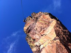 Rock Climbing Photo: Nothing but air! Austin starting down on rappel.