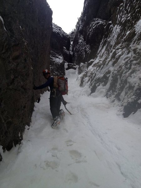 Climbing the snowy first pitch, what would be a technical pitch in early season.