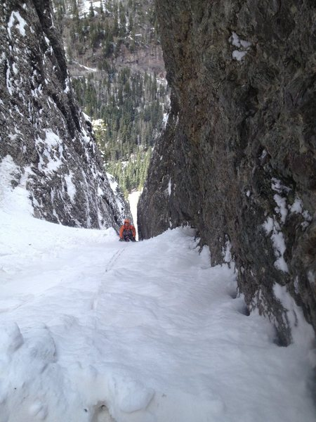 Dan finishing pitch 2.<br> Belay is simply  a hole dug in snow against rock wall.