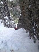 Rock Climbing Photo: Dan finishing pitch 2. Belay is simply  a hole dug...