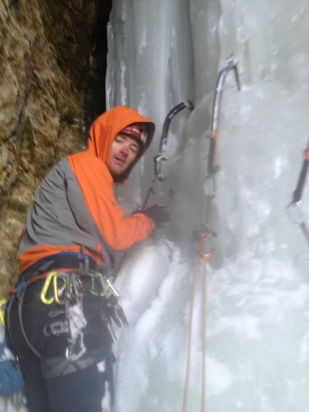 Building a V-thread belay in the exit pitch ice cave.