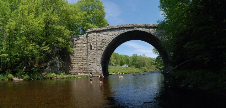 Stone Arch Bridge Keene, NH.  This thing was built way back in the day without motar.  It's quite the structure and great for climbing. Just minutes from campus/mainstreet.  Watch out for poison ivy if you set up on sections other than in pic.